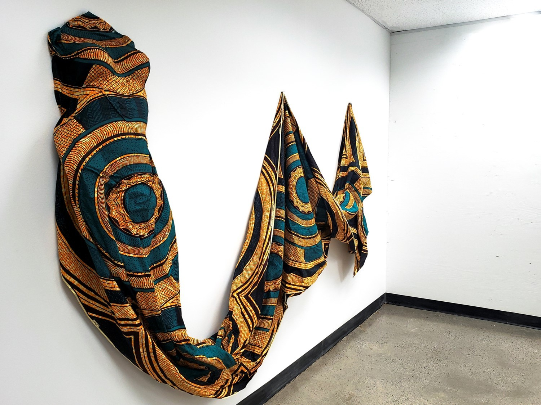 """Nyasha Madamombe, Paying Homage I, 2019, fabric installation, 38"""" x 85"""" x 6.5"""""""