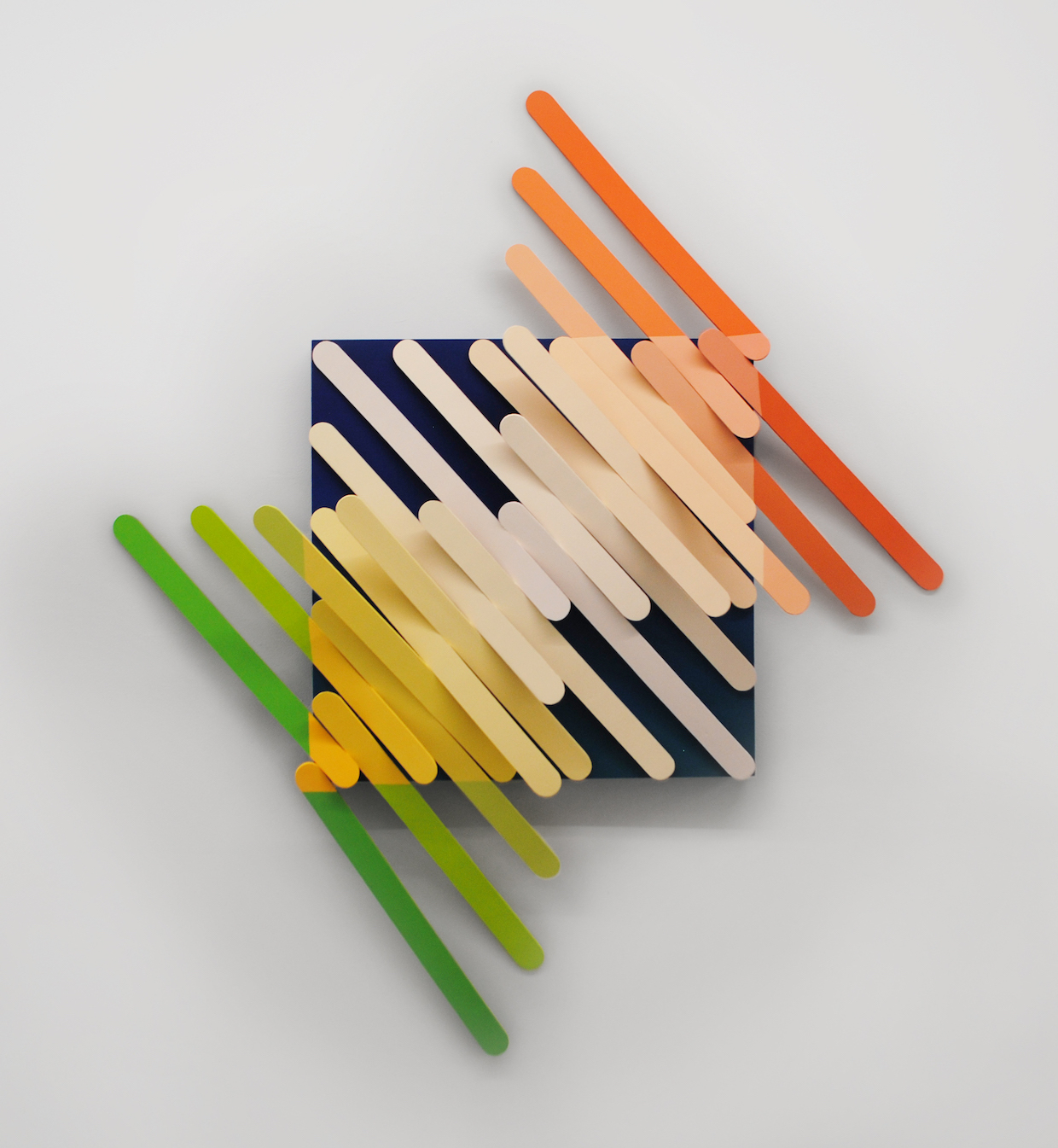"Kayla Rumpp, Teeter, acrylic, foam board, on wood, enlarged popsicle sticks ascending towards the center, 40"" x 40"" 6"", 2019"
