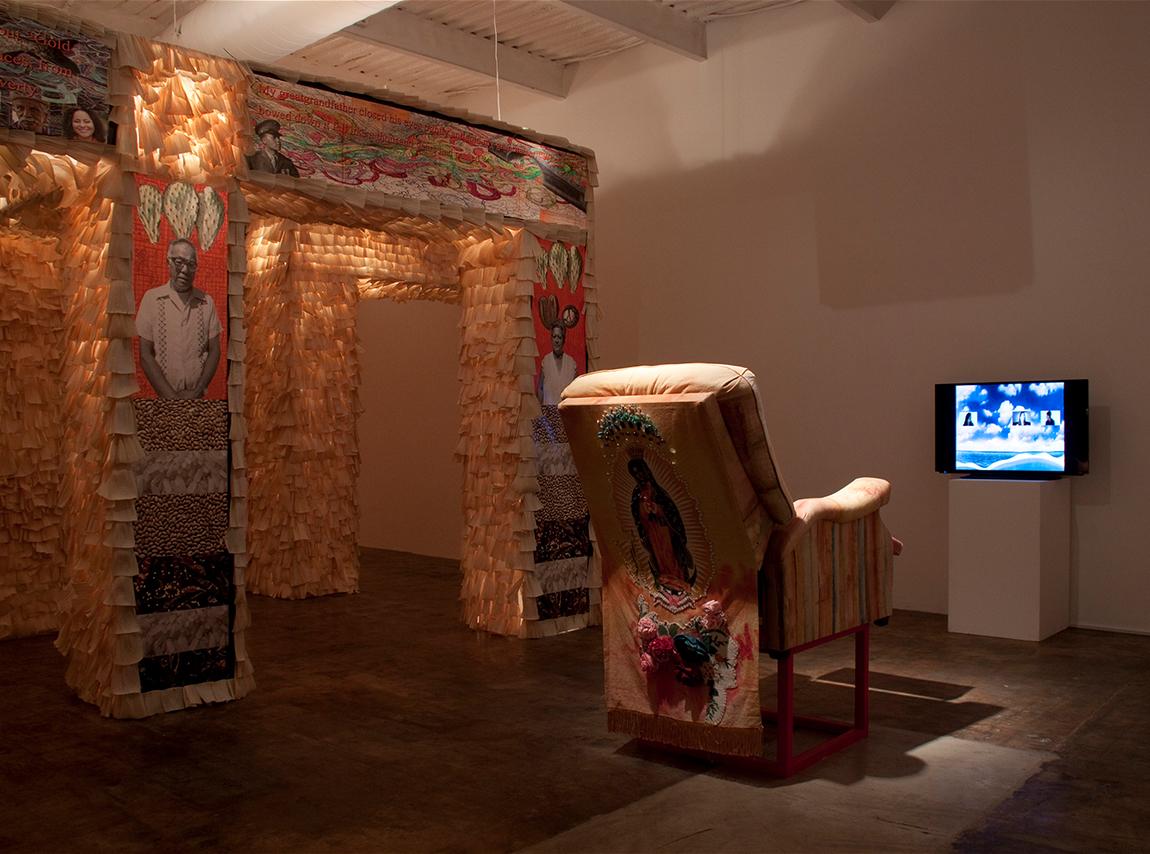 Richard Lou, Stories On My Back, 2016, multimedia installation, corn husks, digital photos, chair, audio, and video