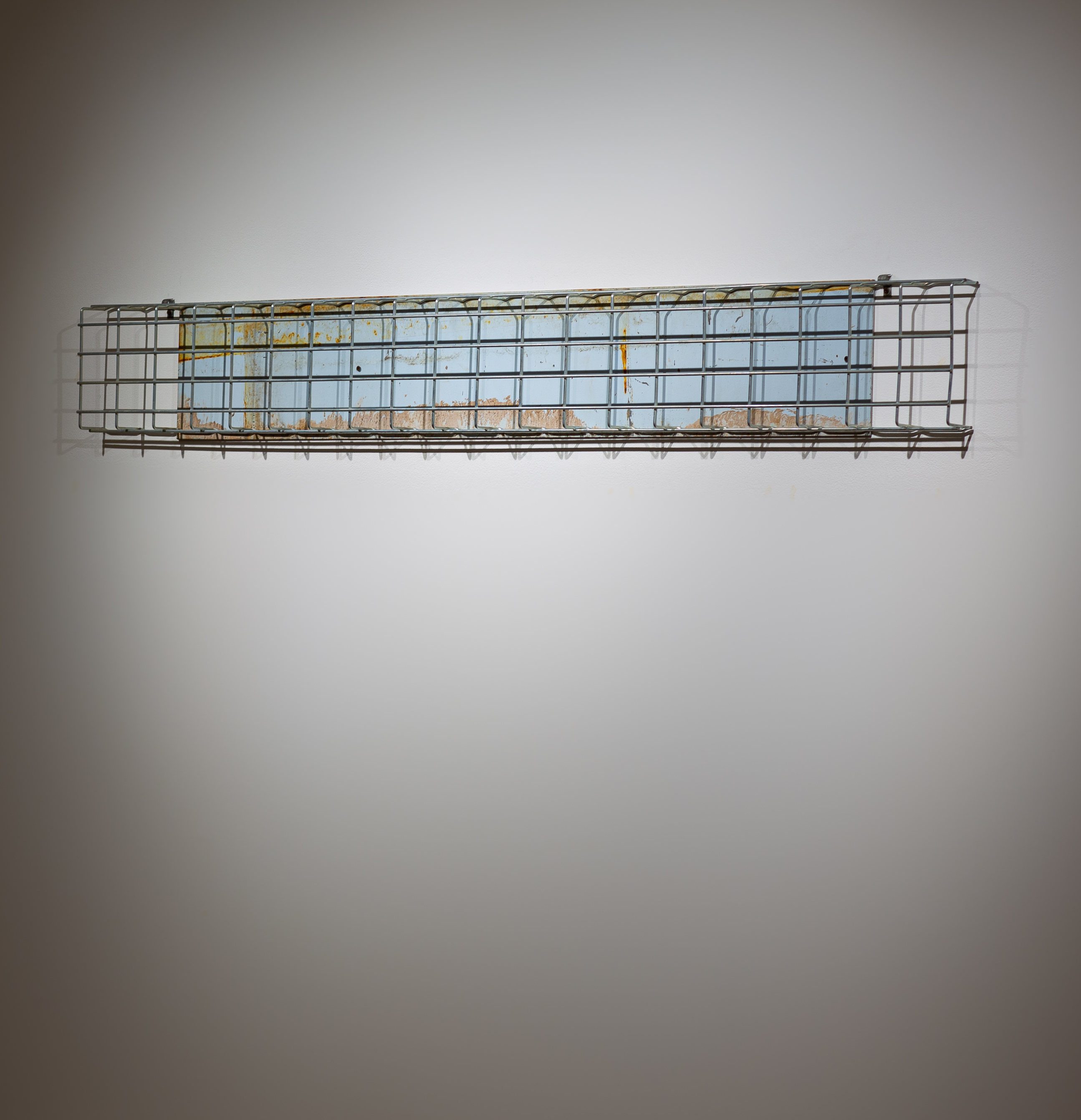 """Tracy Treadwell, Sweet Baby Blue (Holy Terror), 2021 (9"""" x 79"""" x 3"""") painted aluminum, steel grate"""