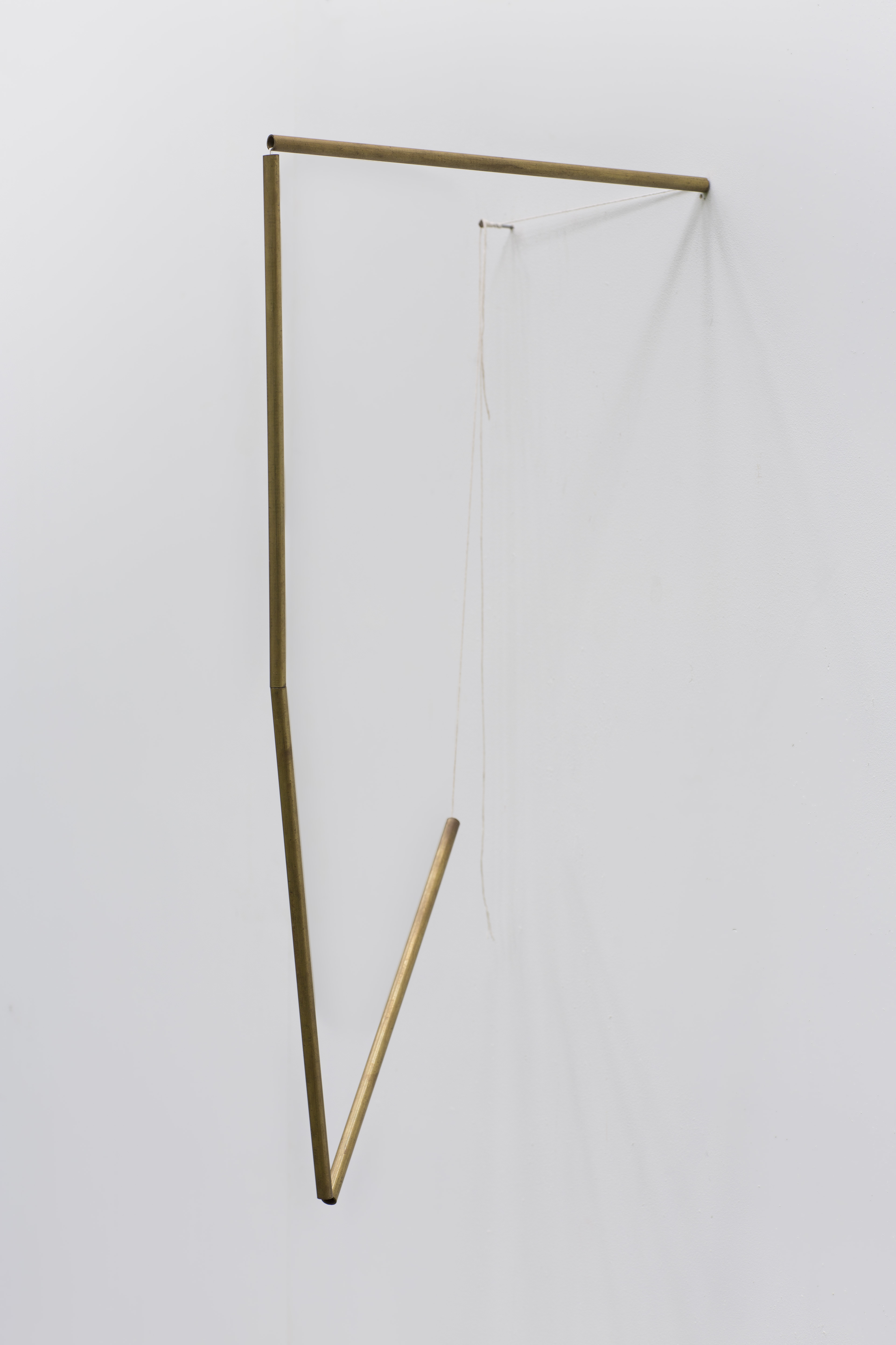 """Tracy Treadwell, When Was My Mother, My Mother Again, 2020 (24"""" x 9"""" x 12"""") brass stem, cotton thread, nail"""