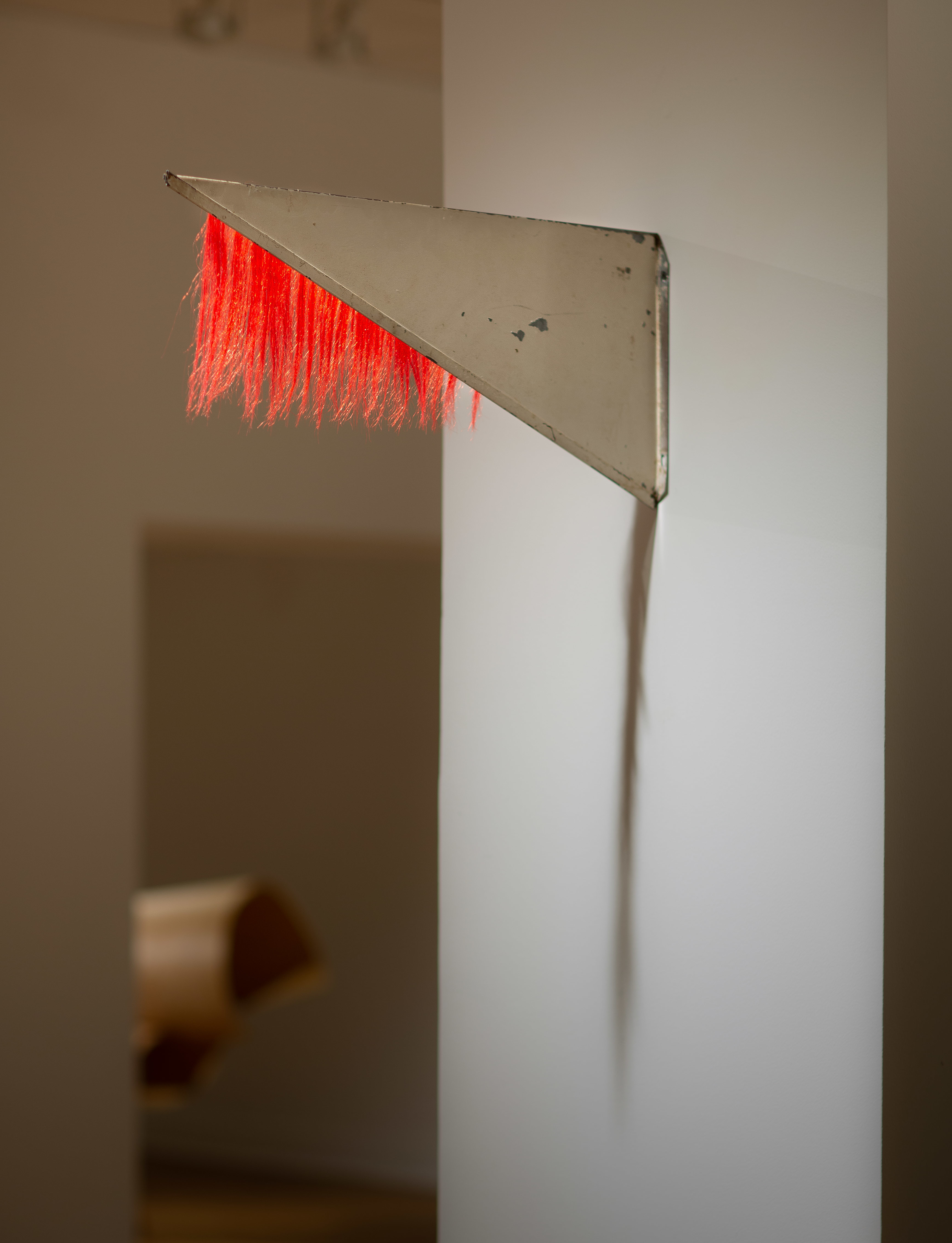 """Tracy Treadwell, Untitled (Revolving Flag), 2020 (8"""" x 18"""" x 1"""") steel sign, synthetic hair"""