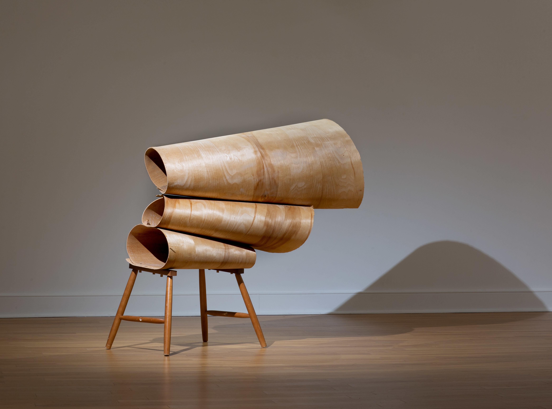 "Tracy Treadwell, Buckled 'Round, 2020 (63"" x 49"" x 18"") Birch veneer bendy ply, oak spindle leg, walnut, glass chandelier coffin prism"