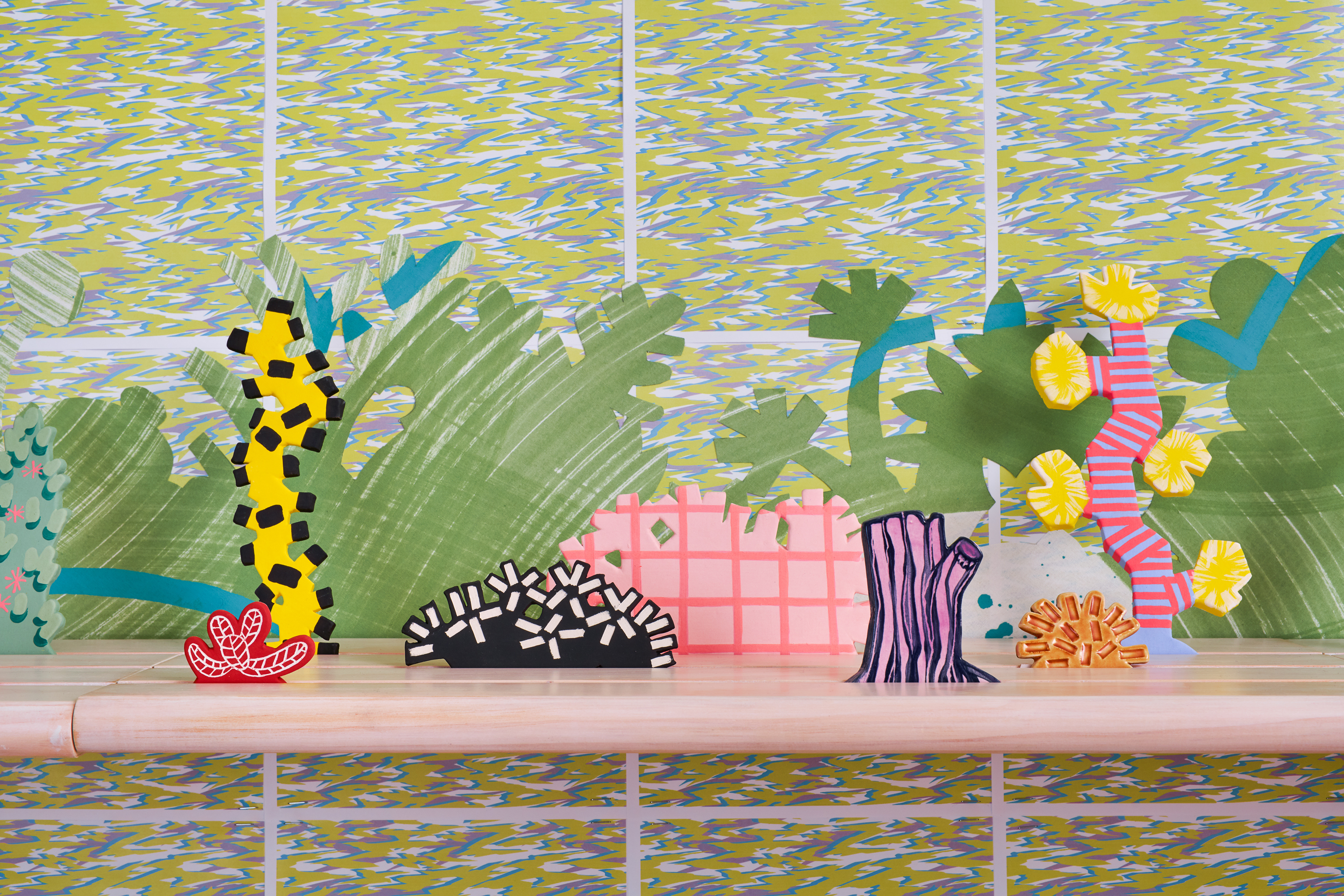 Horizon Allsorts, 2018 (detail); Installation for MILIEU: Erin Harmon and Devon Tsuno, LAUNCH, Los Angeles; Floating wood shelves, painted muslin, ceramic, underglaze and glaze; 6 shelves, each 22.86 x 60.96cm; documentation of this installation includes wall paper by Devon Tsuno