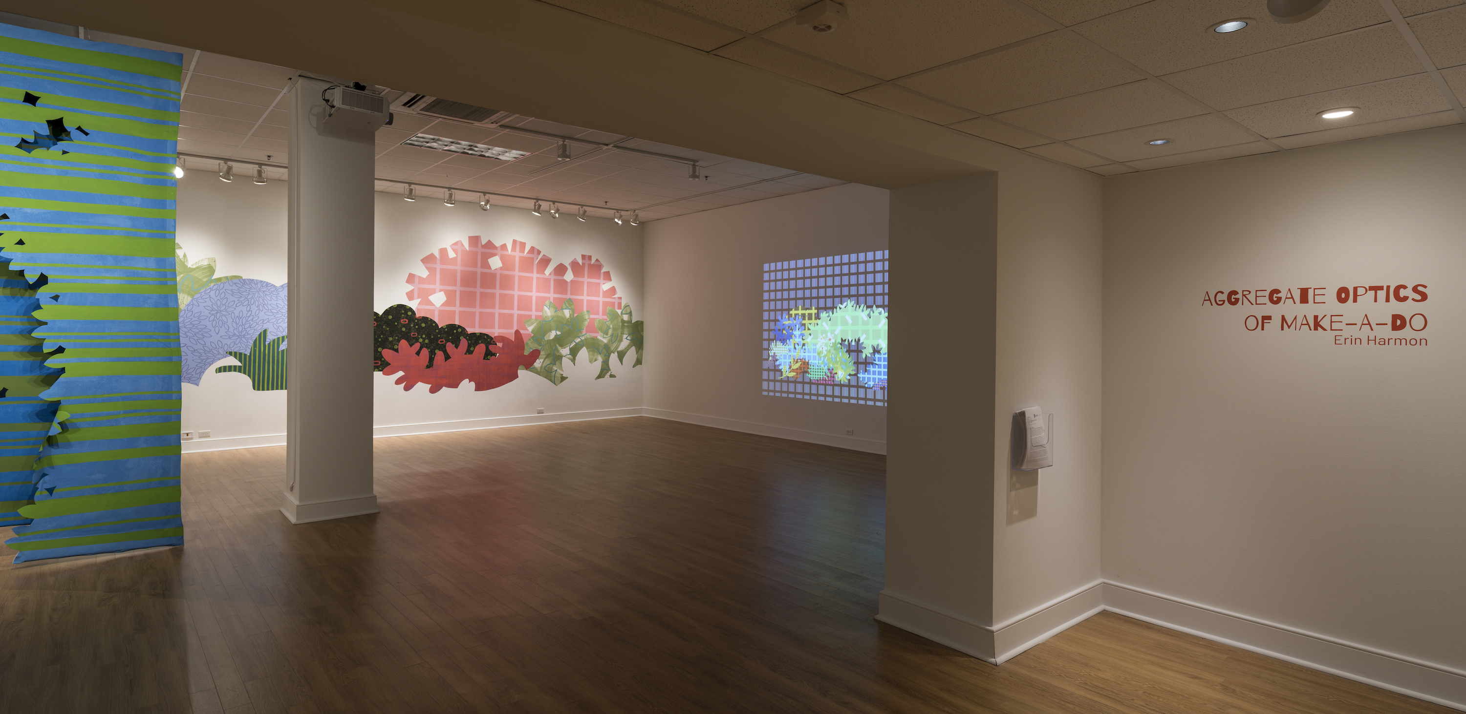 """Installation of """"Aggregate Optics of Make-A-Do"""" 2019; University of Memphis, Fogelman Galleries; Works from right to left: Blinky Bricolage (2019) 3 minute animation on loop, projection; Piecemeal Promenade (2019) 48ft x 11ft; latex on muslin cut-outs, adhered to wall; Proscenium Hedgerow (2018) 11ft x 10ft x 2ft; series of three latex on cut muslin panels"""