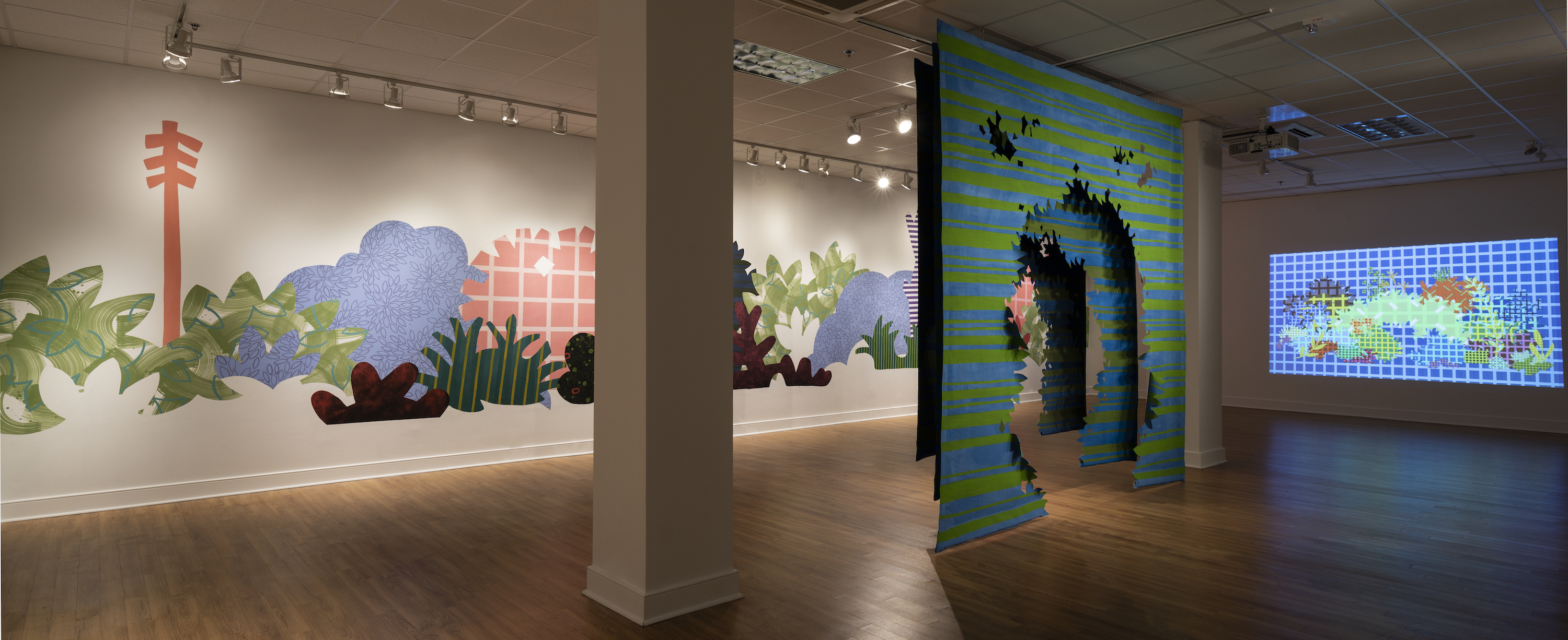 """Installation of """"Aggregate Optics of Make-A-Do"""" 2019; University of Memphis, Fogelman Galleries; Works from right to left: Blinky Bricolage (2019) 3 minute animation on loop, projection; Proscenium Hedgerow (2018) 11ft x 10ft x 2ft; series of three latex on cut muslin panels; Piecemeal Promenade (2019) 48ft x 11ft; latex on muslin cut-outs, adhered to wall"""