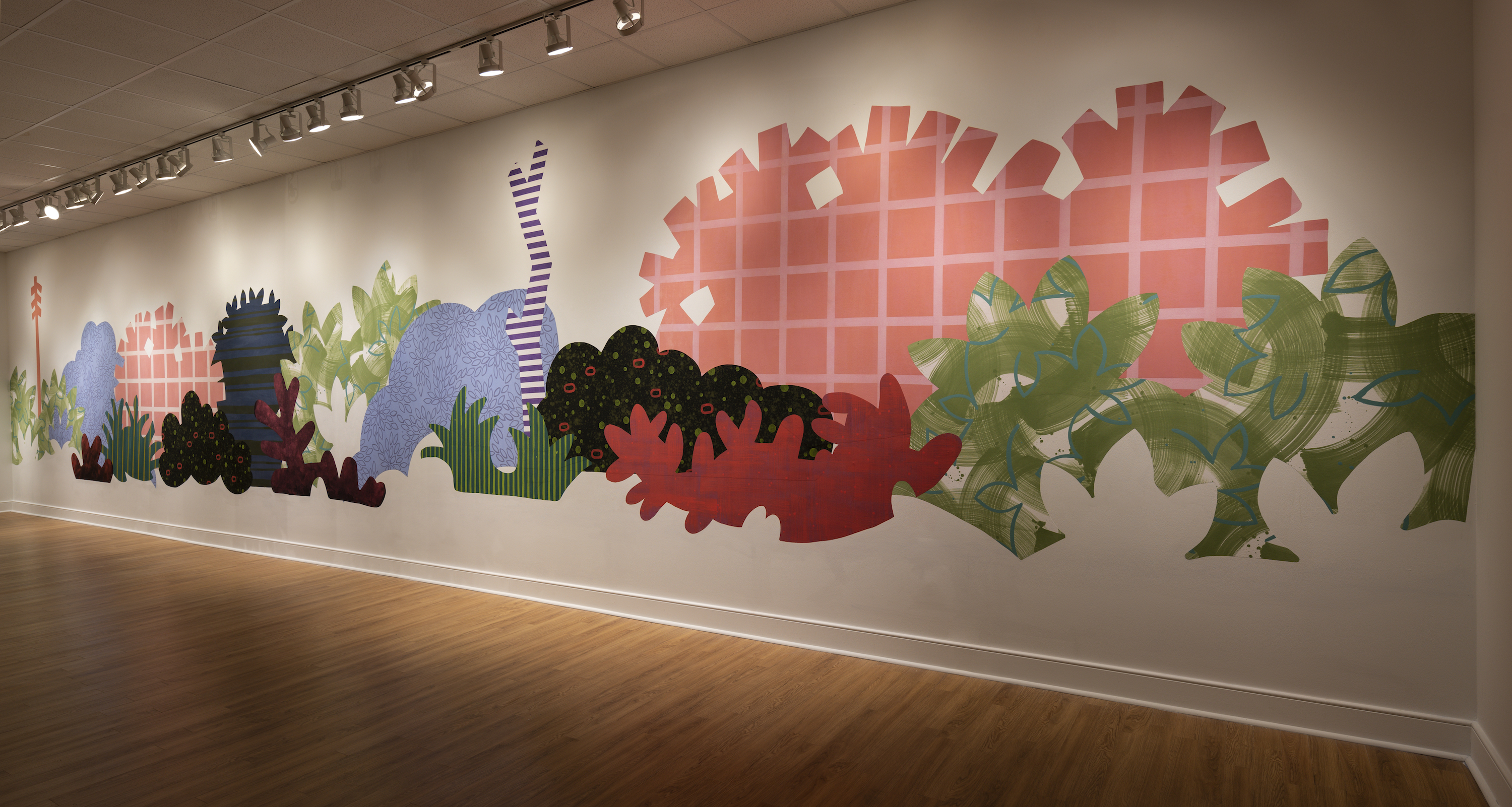"""Installation of """"Aggregate Optics of Make-A-Do"""" 2019; University of Memphis, Fogelman Galleries; Piecemeal Promenade (2019) 48ft x 11ft; latex on muslin cut-outs, adhered to wall"""