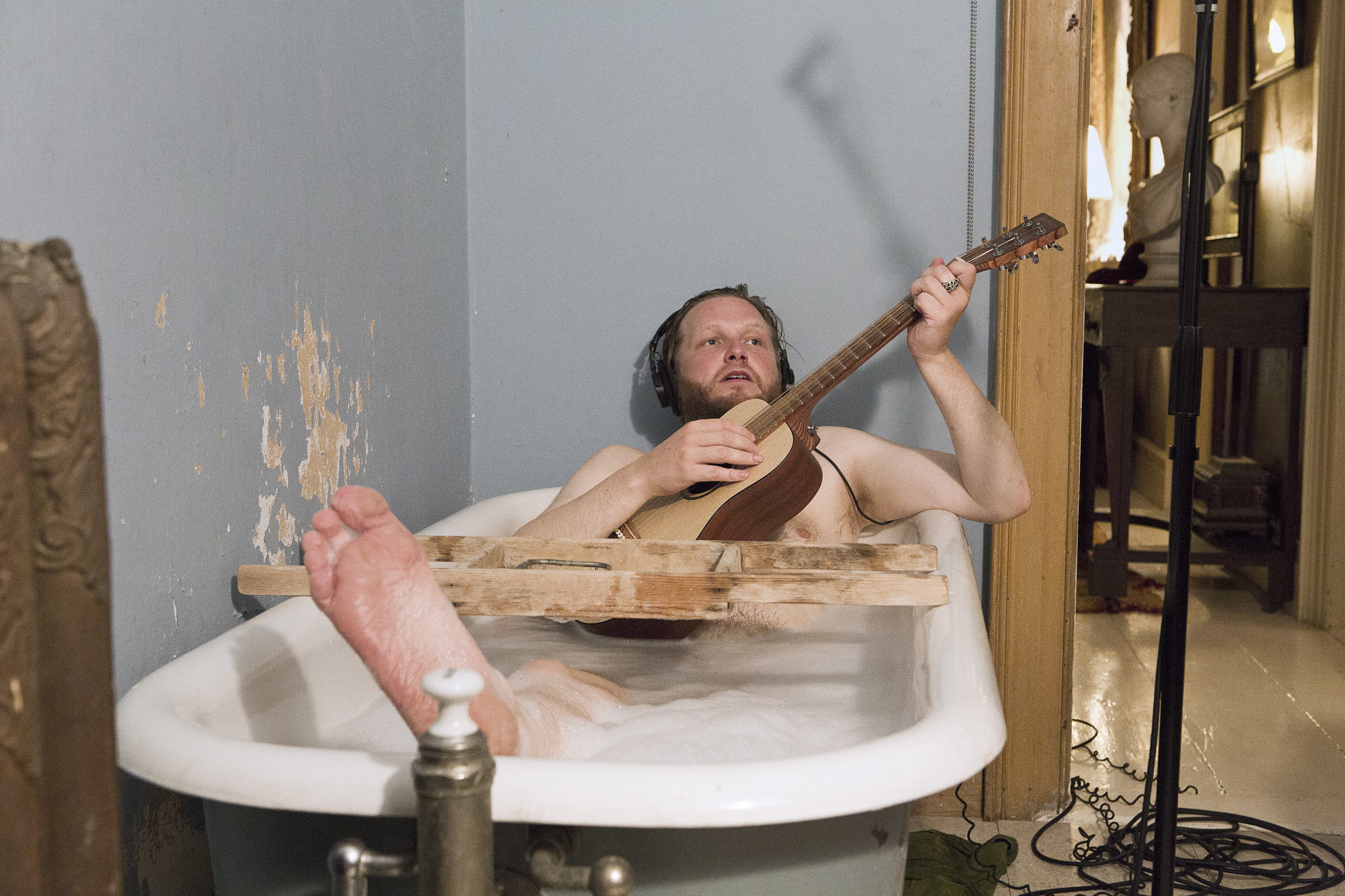 Ragnar Kjartansson. The Visitors, 2012. Nine-channel video projection, 64 minutes. Photo: Elísabet Davids. Courtesy of the artist, Luhring Augustine, New York, and i8 Gallery, Reykjavik. NOTE: The image of the man in the bathtub is an image of the artist.