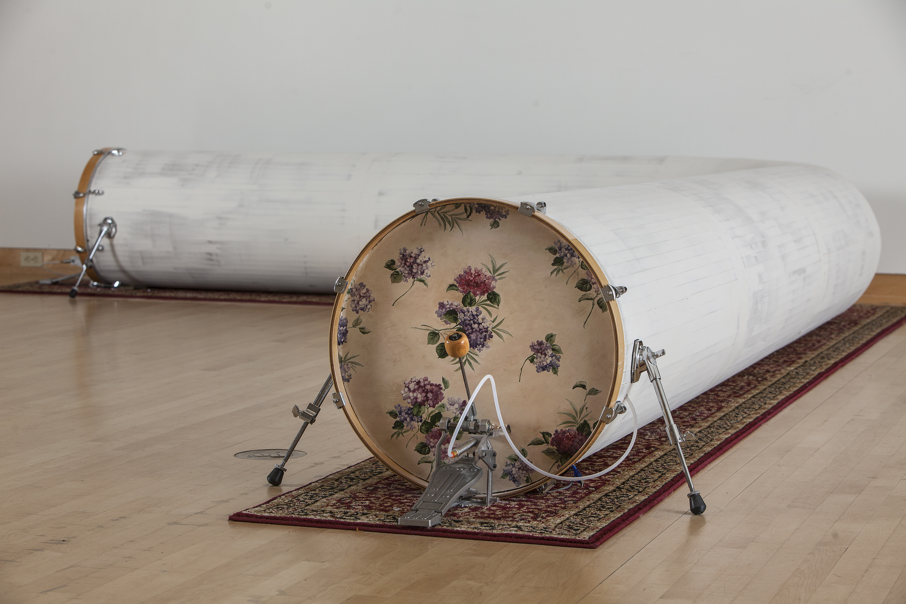 Scott Carter, Safe as Houses, drywall, drum set hardware, wallpaper, carpet, air compressors, proximity sensors, micro controllers, pneumatic bass drum pedals (2015)- photo by Jeff Machtig