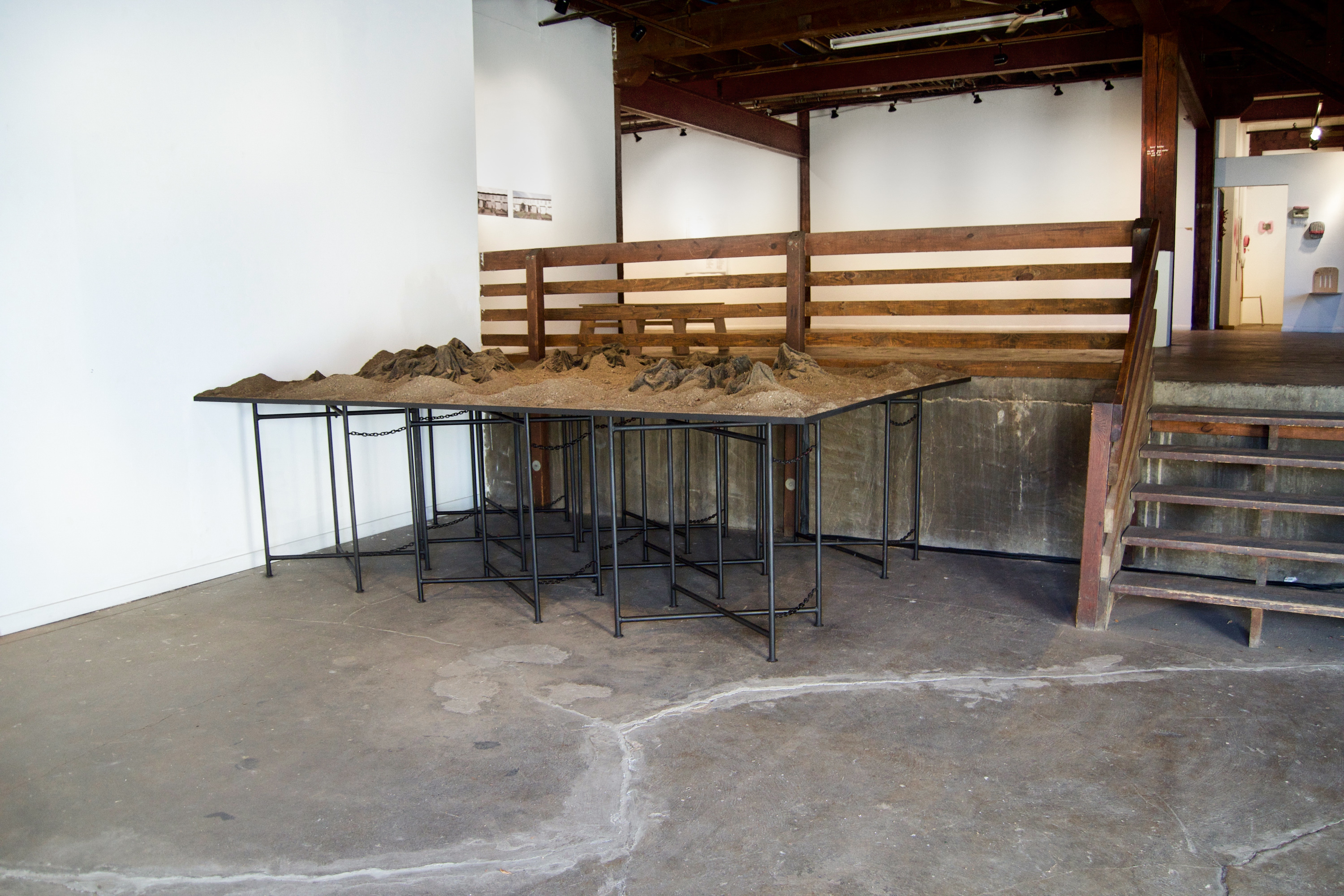 """Caroline Hatfield, Land and Water, 2019, 45"""" x 144"""" x 96"""", mortar stands, plywood, crushed recycled concrete, resin bonded concrete, aluminum, dyed water, water pumps"""